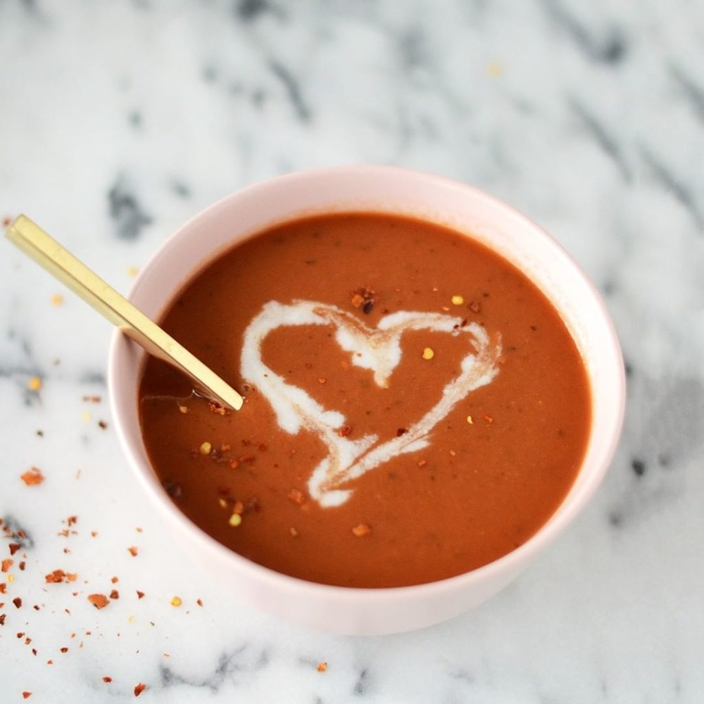 A bowl of vegan tomato soup with red pepper